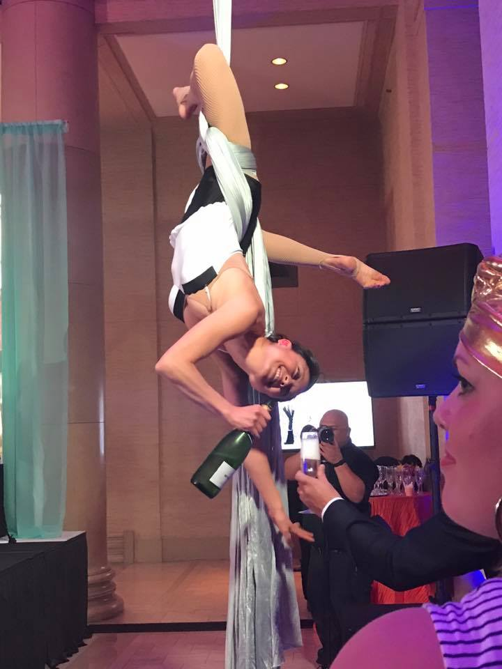 Acrobatics Dancers with Wine Swing into Spring
